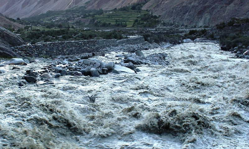 A flooded river in Chitral Valley. - Photo courtesy: Syed Zahid Hussain