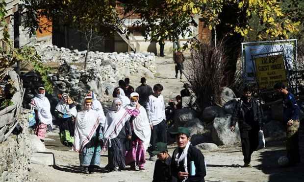 Kalash students return from school in Brun village of the Bumboret valley. — AFP