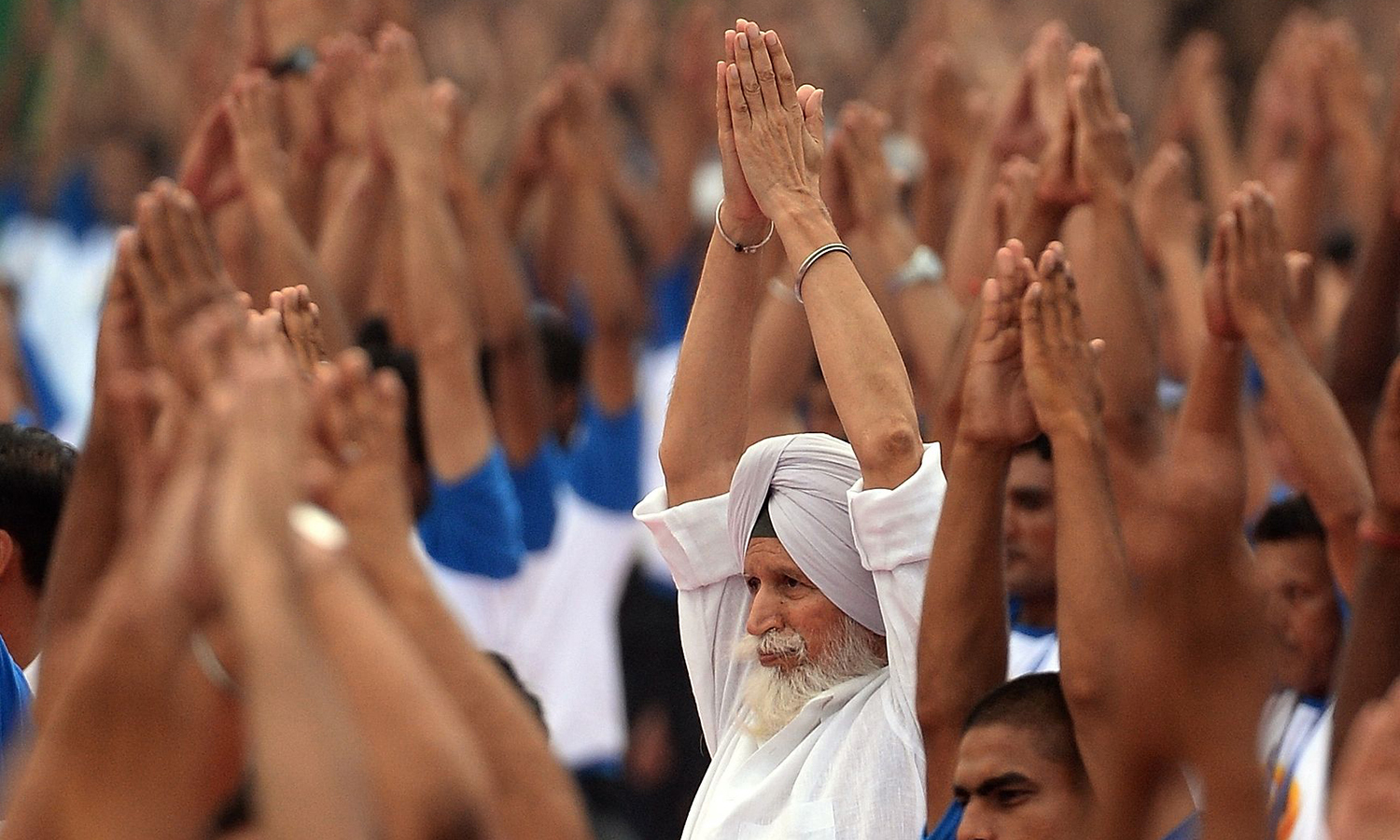 Indian yoga practitioners participate in a mass yoga session to mark the International Yoga Day at Capitol complex in Chandigarh. AFP