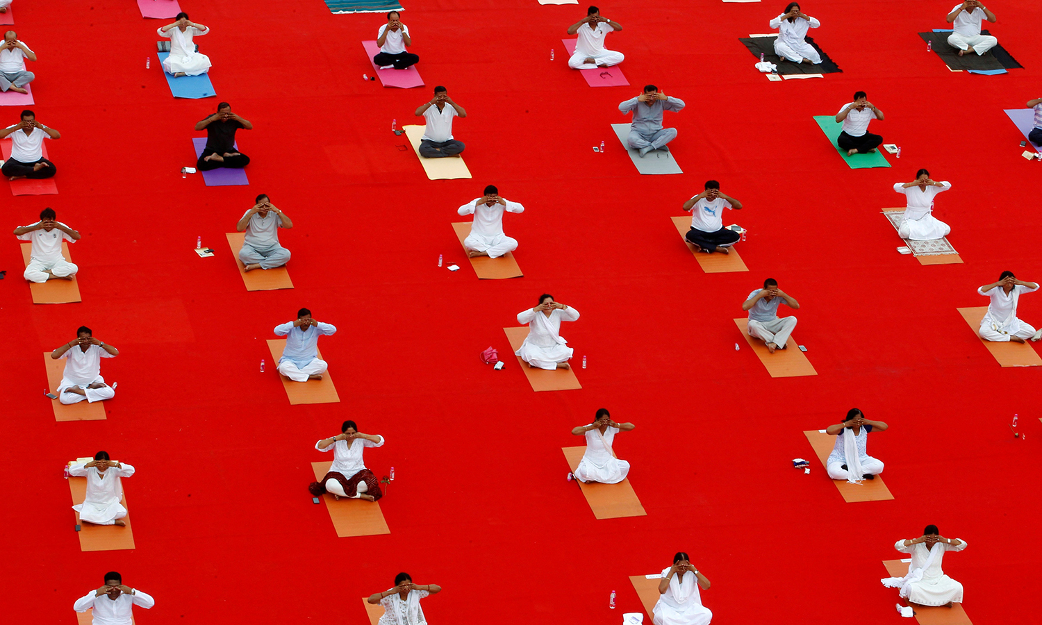 Participants perform yoga during World Yoga Day in Ahmedabad. Reuters