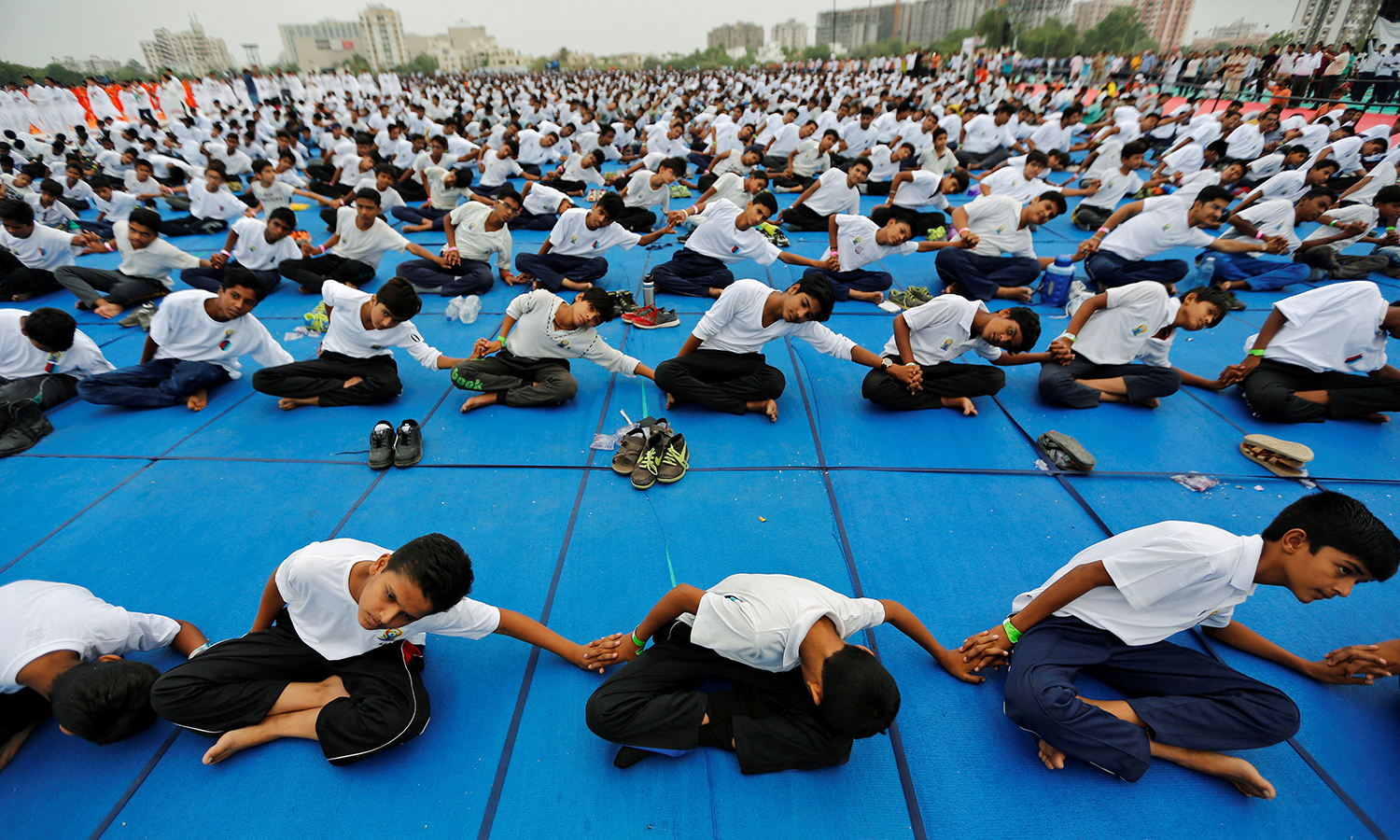 Participants perform yoga during World Yoga Day in Ahmedabad, India. Reuters