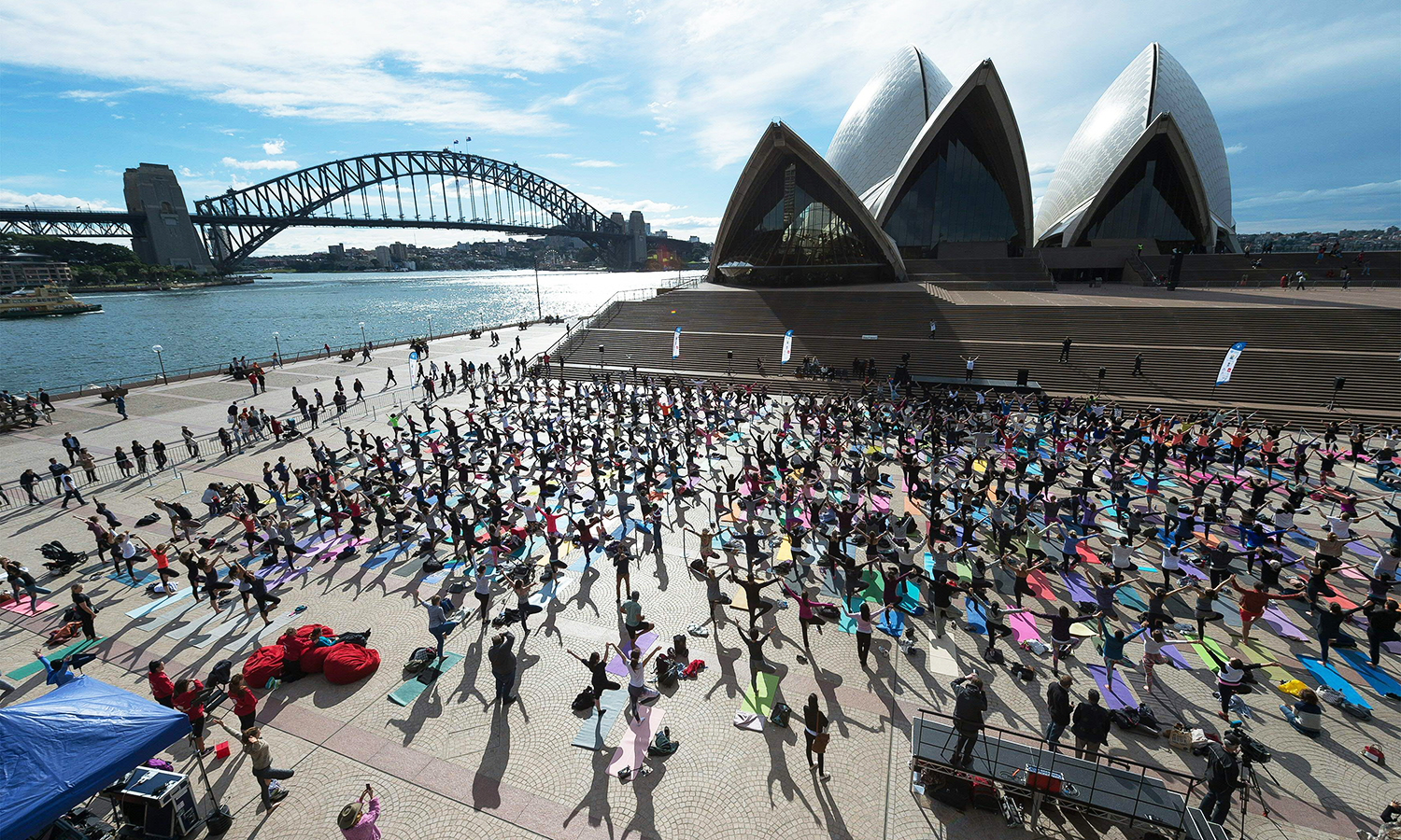Sydneysiders enagage in a yoga event in front of the Australia's iconic landmark Opera House in Sydney. Hundreds of Yoga lovers gathered at Opera House to mark the International Yoga Day. AFP