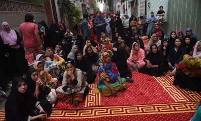 People gather outside Amjad Sabri's house after the attack on the qawwal.