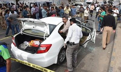 Security officials inspect Amjad Sabri's car.