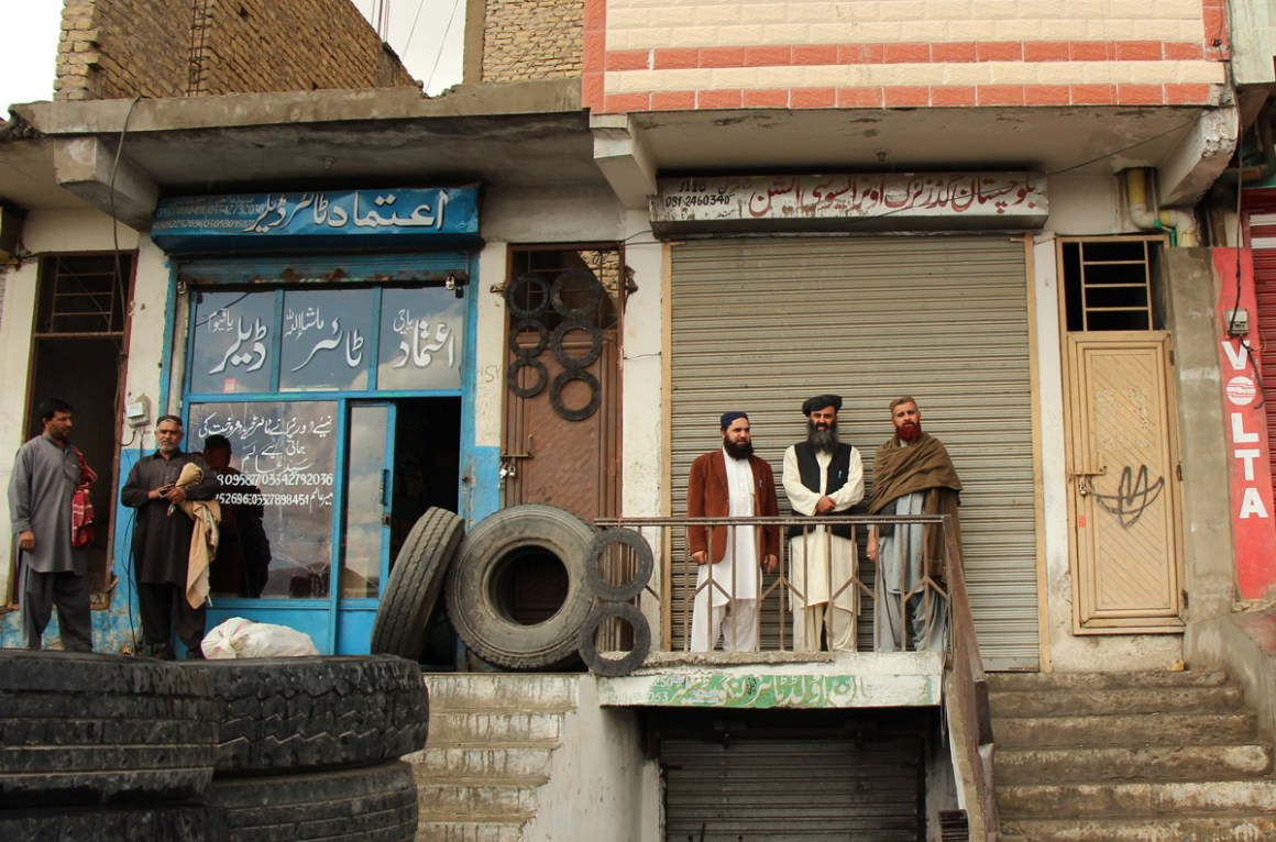 Haji Gul Kakar stands in front of the Balochistan Goods Truck Owners Association, Quetta