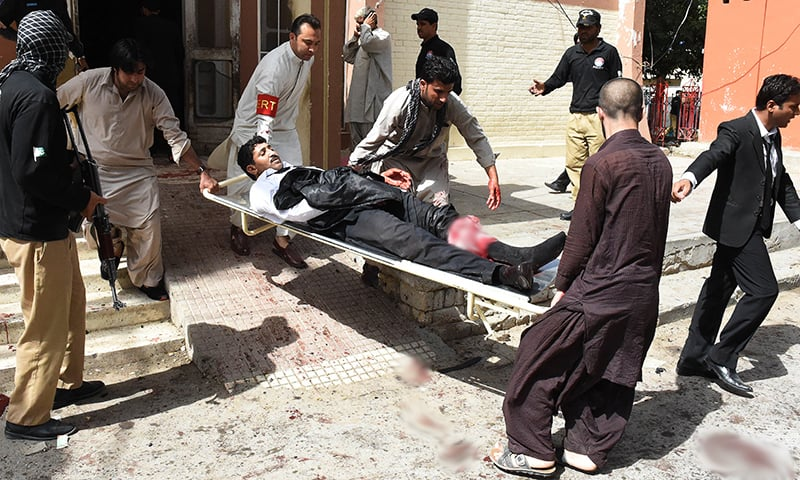 Volunteers use a stretcher to move an injured lawyer after the explosion.— AFP