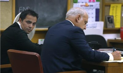 Chahal sits with his attorney James Lassart during a hearing to consider revocation of his probation on domestic violence charges in July, 2016 ─ AP