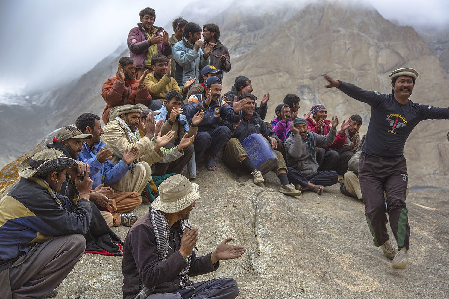 Porters singing and clapping as we celebrated Eid. A Pakistan Army officer stationed at Urdukas joined in the celebrations.