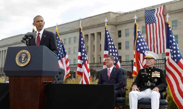 President Barack Obama speaks at a memorial ceremony at the Pentagon to commemorate the 15th anniversary of the 9/11 terrorist attacks. — AP