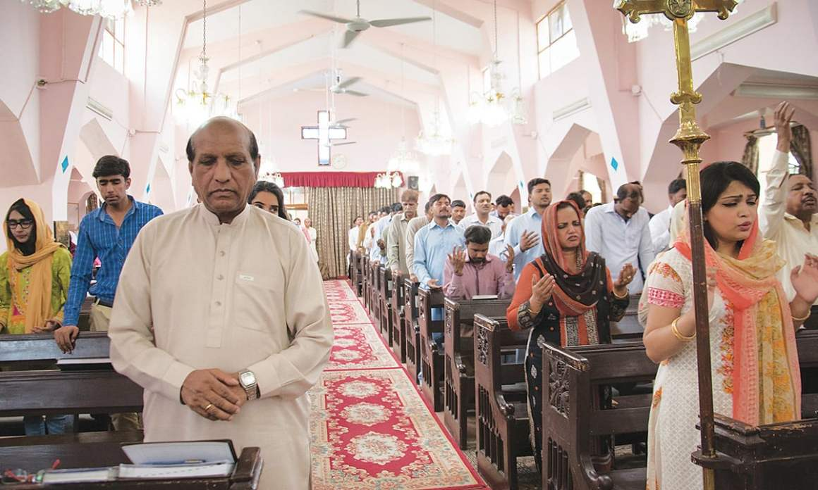 William Barkat (front left) offers prayers at St. Mary's Church | Sara Faruqi