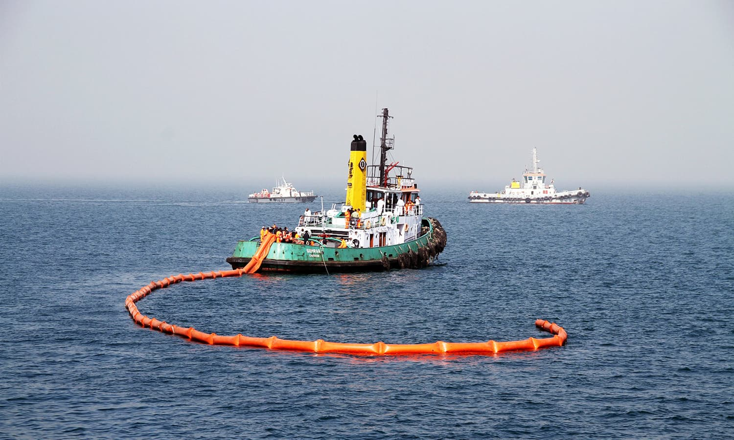 Pakistan Navy and Maritime Security Agency assets deploying oil spill equipment during marine oil containment exercise. ─Navy PR