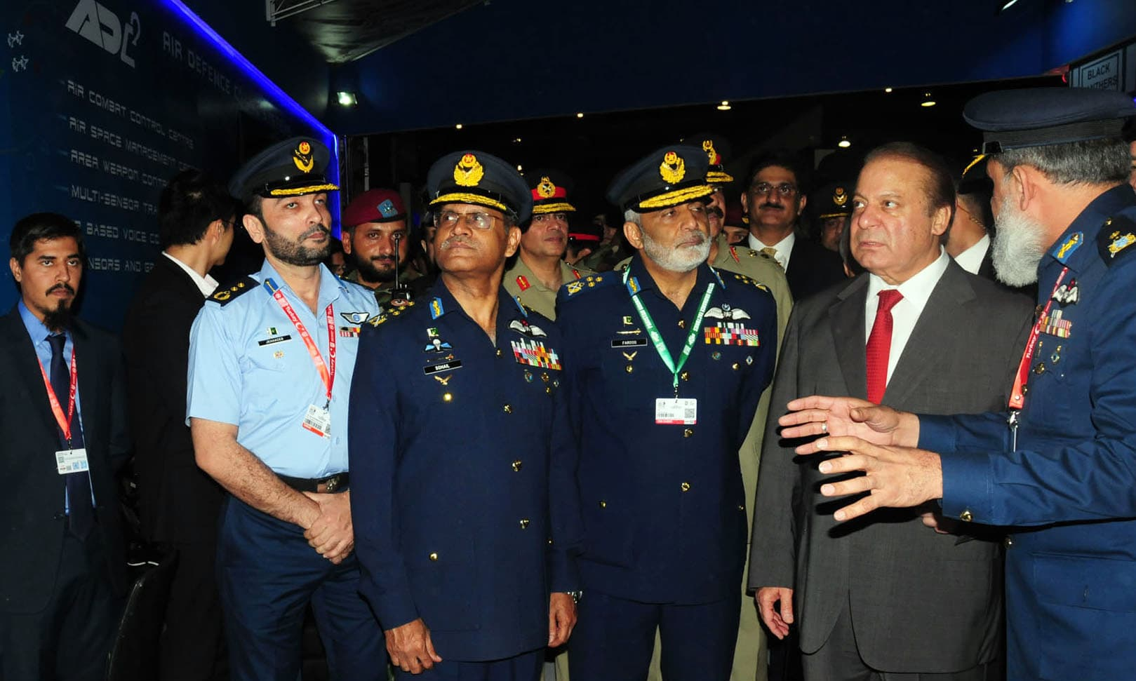 PM Nawaz Sharif is being briefed at PAF stall during inauguration ceremony of IDEAS-2016. —PPI