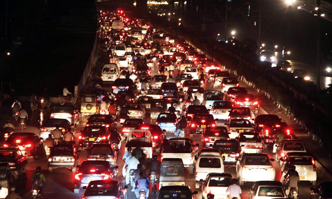 A view of massive traffic jam at Shahrah-i-Faisal due to closing of roads near Expo Centre due to IDEAS-2016. —Online