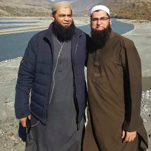 One of Junaid Jamshed's final photographs taken with friends posing against the snowcapped Tirchmir in Chitral