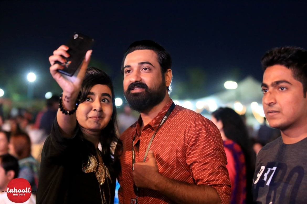 Saif Samejo pauses for selfies with young attendees of Lahooti Melo