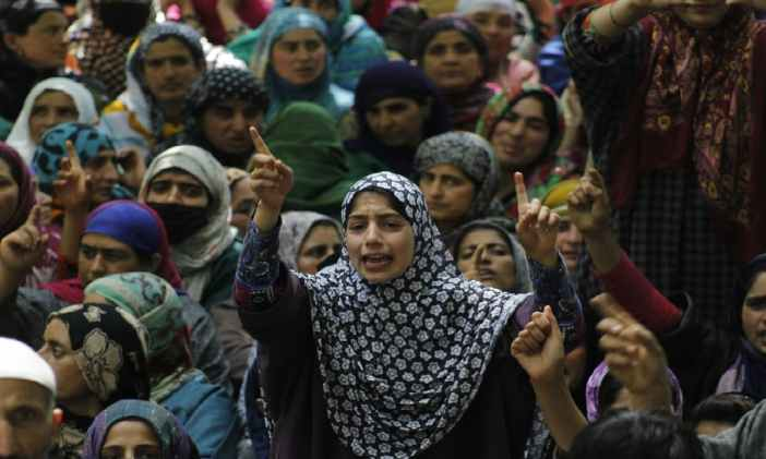 A Kashmiri girl shouts slogans during the funeral procession of a civilian, Adil Magray, in Shopian in June 2017