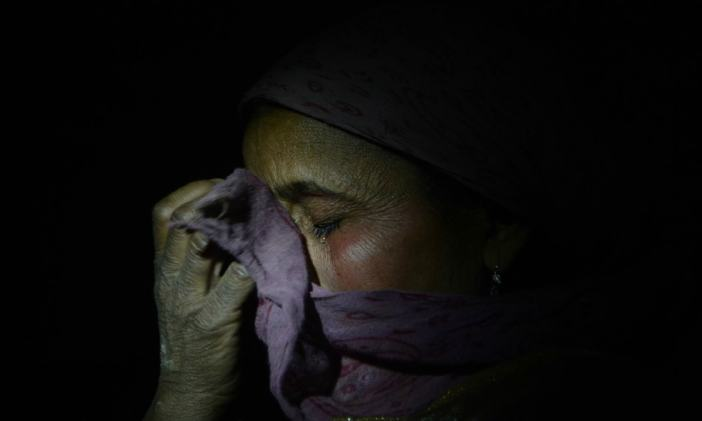 A woman wails at the death of a civilian at her village in North Kashmir on March 15, 2014