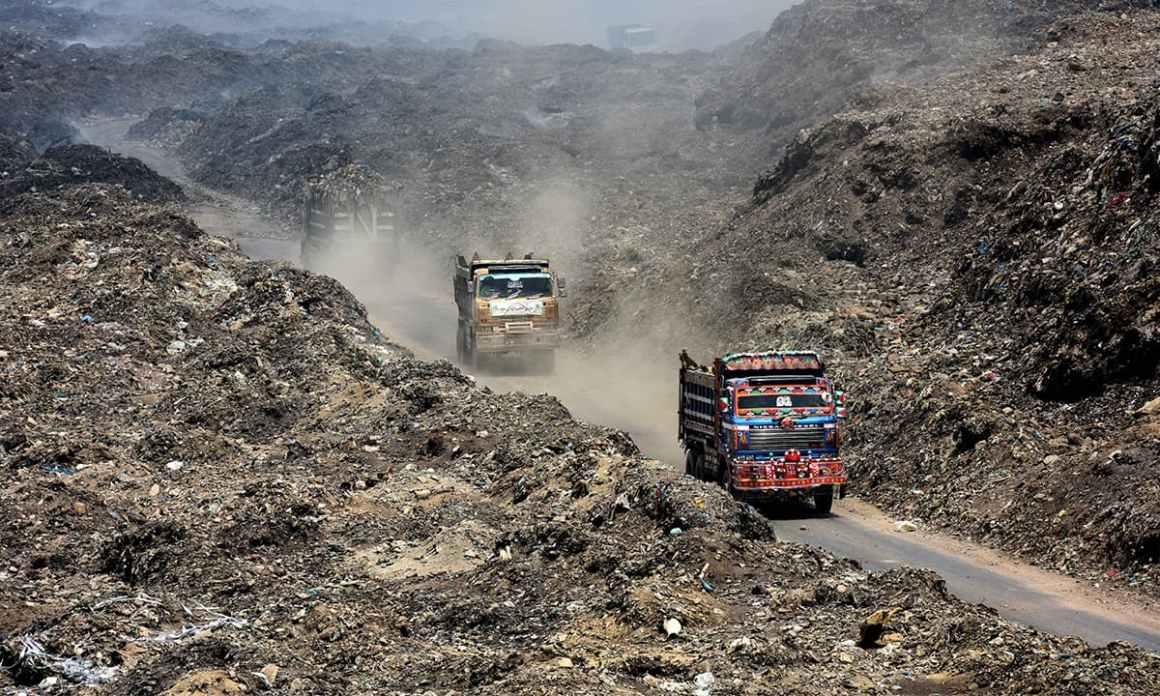 Trucks exit Karachi's Jam Chakro landfill site   Tahir Jamal, White Star