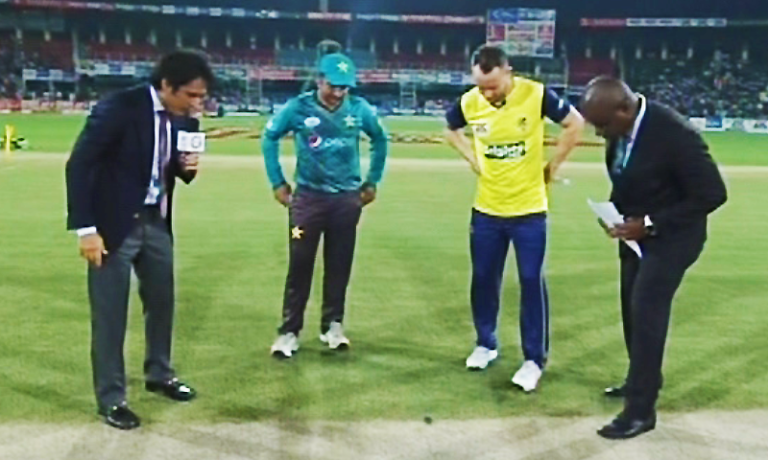Faf du Plessis and Sarfraz Ahmed call the toss for the first fixture of the series. — DawnNews