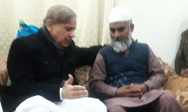 Punjab Chief Minister Shahbaz Sharif offers his condolences to Zainab's family in Kasur on Thursday. ─ Photo courtesy Punjab government official Twitter