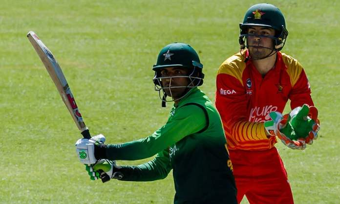 Pakistan batsman Fakhar Zaman (L) prepares to play a shot next to Zimbabwe's wicket keeper Ryan Murray. — AFP