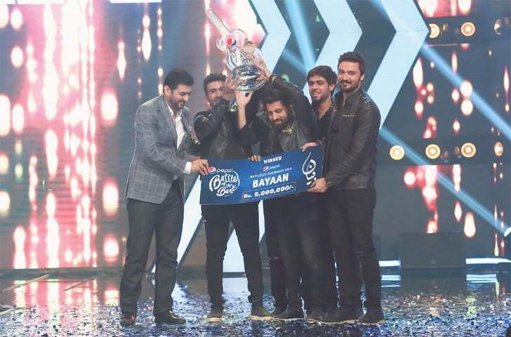 The PBOB winning band Bayaan with the trophy and cash prize