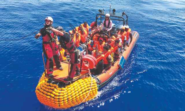 Image result for Over 500 rescued migrants remain stranded at sea