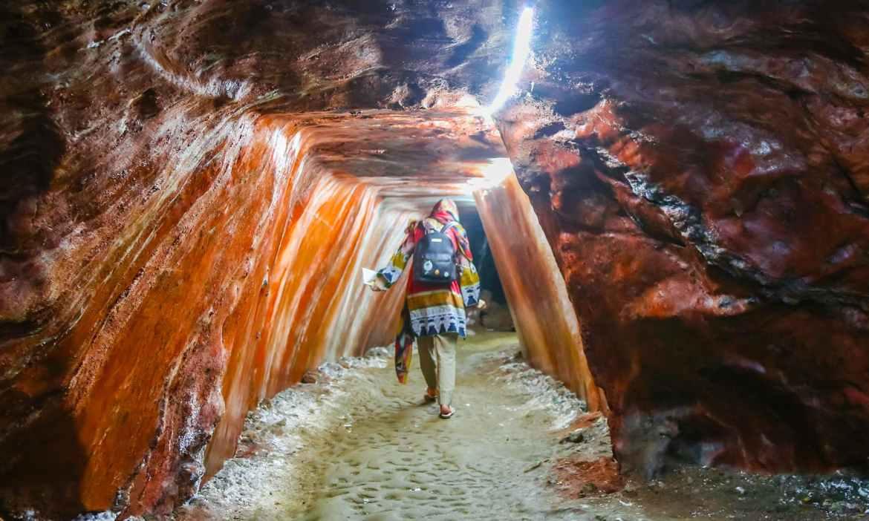 A tourist walks around a salt cave inside the Khewra Salt Mines.