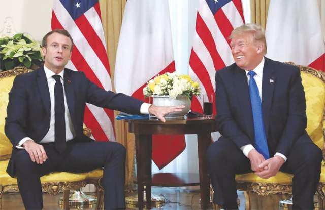 LONDON: France's President Emmanuel Macron gestures during the meeting with US President Donald Trump ahead of the Nato summit on Tuesday.—Reuters