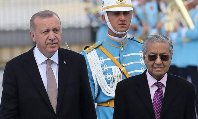 Two of the world's most outspoken leaders, Malaysia's Prime Minister Mahathir Mohamad (R) and Turkey's President Tayyip Erdogan (L) will be giving their views during the four-day summit. — AFP/File