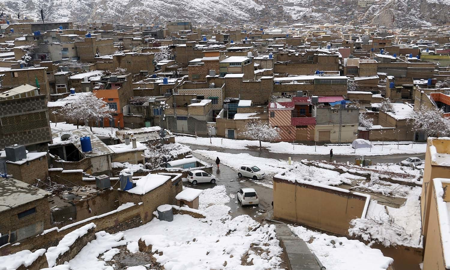 A view of residential area after a snowfall in Mariabad, Quetta. — Reuters