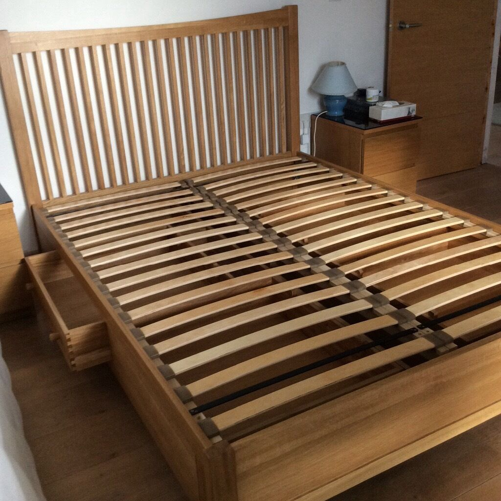 King Size Feather And Black Solid Oak Storage Bed