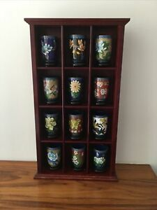 12 Cliosonne Cups With Stands In A Display Cabinet