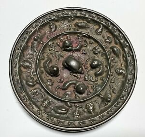 Antique Chinese Bronze Mirror with Lions and Grapes