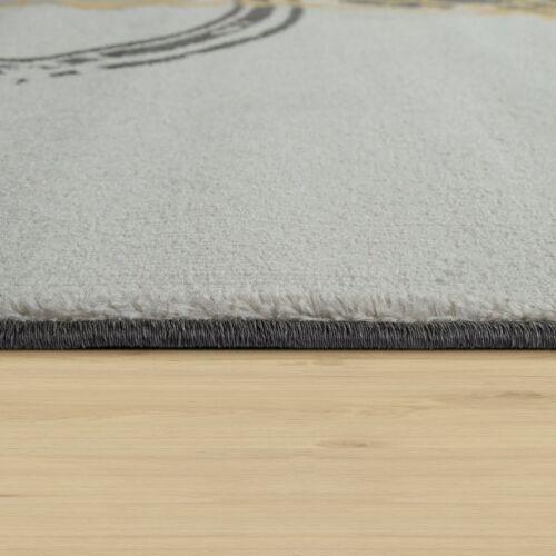 tapis salon moderne motif poils ras abstrait cercles jaune gris blanc