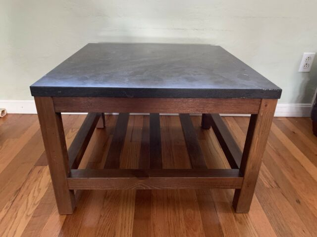 pottery barn square marble top coffee table great condition wood legs