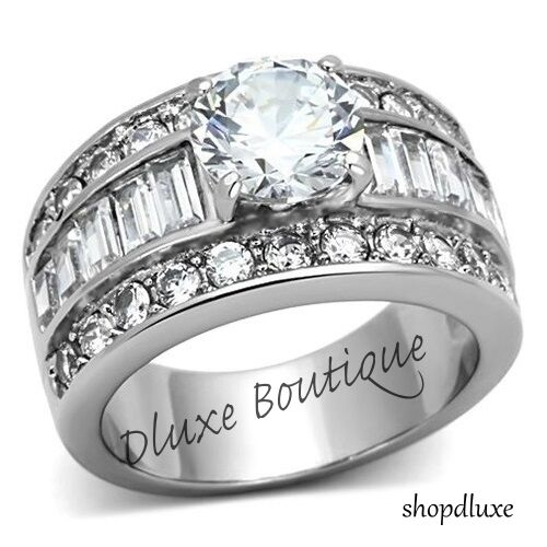 STUNNING ROUND CUT CZ STAINLESS STEEL WIDE BAND ENGAGEMENT