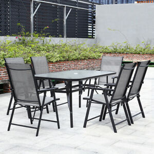 foldable dining table in garden patio