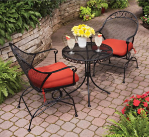 red wrought iron tabletop patio