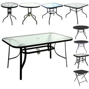 glass top patio table in garden patio