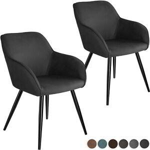 chaises scandinaves en tissu salle a