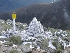 Rime-ice covered cairn.