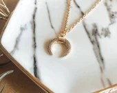 Gold pave crescent pendant necklace