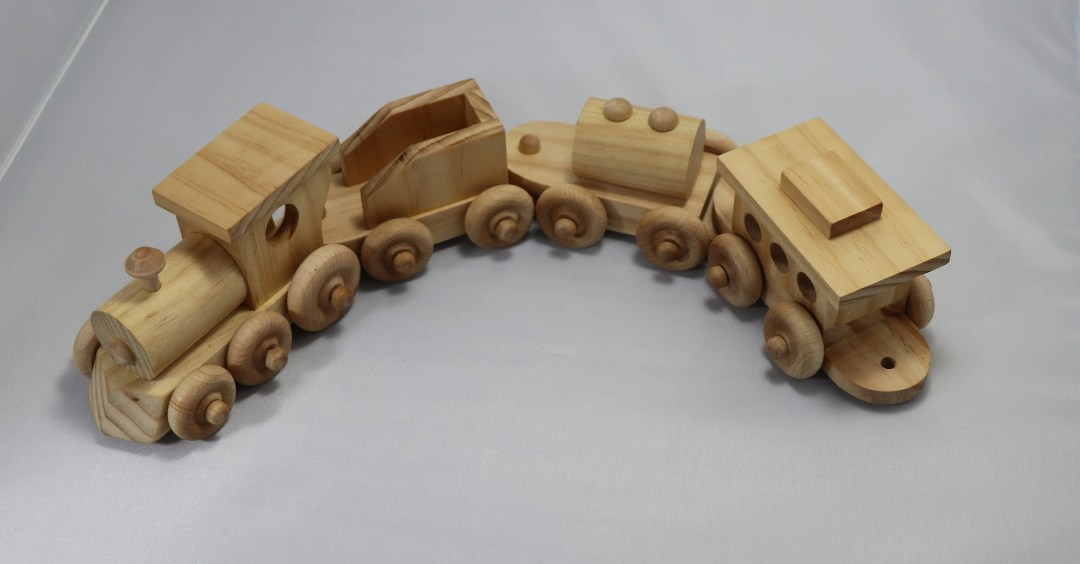 Wooden toy train set with...