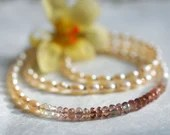 Pearl necklace with tourm...