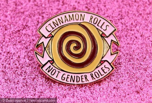 Cinnamon Rolls Not Gender Roles Feminist Enamel Pin with a cinnamon role at the center