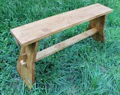medieval bench made with interlocking wood, furniture for middle age historical camp, furniture complement for rustic country house