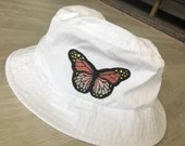 White Bucket Hat with butterfly patch