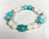 Blue Amazonite stone bracelet and white pearl with turtle charm. Jewelry, elastic bracelet