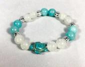 Blue Amazonite stone bracelet and white pearl with turtle charm. Jewelry, elastic bracelet